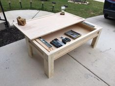 Pine top coffee table with sliding top reveals a hidden storage