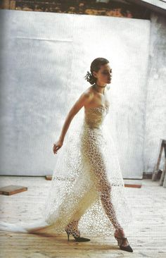 """""""Couture Clash,"""" featuring Shalom Harlow, photographed by Peter Lindbergh for Vogue (April 1997)."""