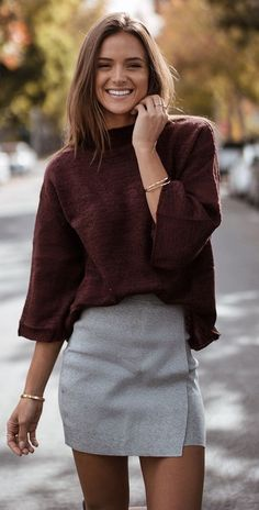 Cute burgundy top with gray wrap mini skirt.