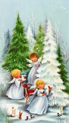 Angels decorating Christmas tree in woods