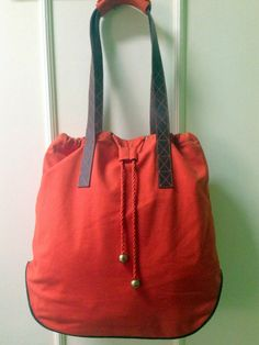 Color me, orange! Orange canvas shoulder bag, with leather straps, detailing and piping. Size: 46 cms x 39 cms Price: Rs 3000 For details of the products and to place an order, you can whatsapp on 9999968917, +34630292108 or email at veralikasingh@hotmail.com or maddy_rawat@hotmail.com.