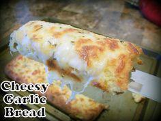Cheesy Garlic Bread Recipe Breads with almond flour, coconut flour, egg whites, olive oil, warm water, yeast, coconut sugar, shredded mozzarella cheese, salt, baking powder, garlic powder, xanthan gum, shredded mozzarella cheese, butter, garlic powder, salt, italian seasoning