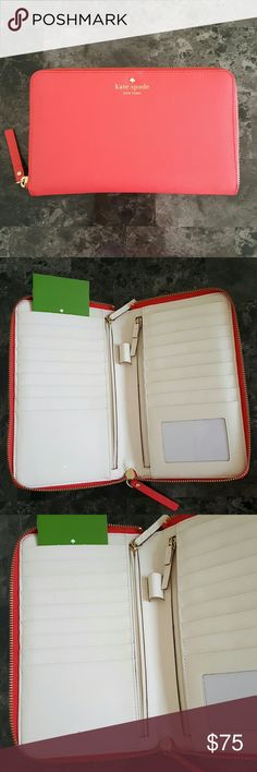 Kate Spade MIKAS POND TRAVEL WALLET Kate Spade MIKAS POND TRAVEL WALLET Geranium color (slightly used).  I'm selling it for $65.00 .  This wallet can hold up to 17 Credit Cards or Cards and two Big side zippers both left and right, 1 ID slot, 1 pen holder and at the back of the wallet it has one big pocket. It is a crosshatched leather with matching trim and 1 care card. kate spade Bags Wallets