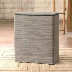 Keep your laundry better organized in this quality brown hamper made from high-quality polyester fabric and a sturdy plastic frame. The matching hinged lid will keep dirty laundry out of sight. Clean it with a damp cloth for easy care.