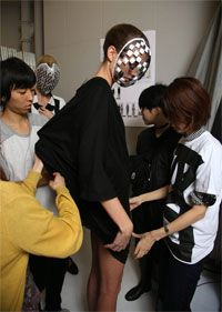 Models and Stylists backstage at Anrealage
