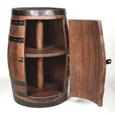 Custom hand-made bar. We have a variety of refrigerator-style barrels, shelve and mini bars styles available. whisky barrels for sale. bourbon barrels for sale. old whiskey barrels for sale. Whiskey Barrels For Sale, Whiskey Barrel Table, Wine Barrel Bar, Whiskey Barrel Furniture, Bourbon Barrel, Mini Bars, Bar Furniture, Antique Furniture, Outdoor Furniture