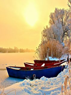 Two rowboats on a frozen lake