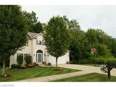 Property For Sale $194,900 Private wooded views in this Gorgeous Woodsong Colonial