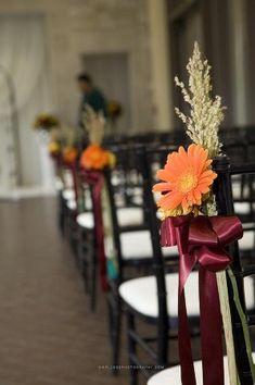 Fall wedding aisle decoration- a simple Gerber Daisy and ribbon (fall wedding colors peacock)