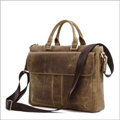 "Crazy horse Leather Men's Brown Briefcase Handbag Shoulder Tote 15"".-Size approximately 15""L x 3""D x 12""H inches (38cm L x 7.5cm D x 30.5cm H)-Brown color-Weight: 1.118KG-Double handle approximately 8.5"" inches (21.5cm) long 4"" inches (10cm) drop be able to used comfortably, including an extra adjustable long strap, this purse may do four uses: briefcase, laptop bag, handbag, messenger bag- http://vintagebags.bigcartel.com/product/crazy-horse-leather-men-s-brown-handbag"