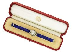 An Art Deco Lapis Lazuli and Diamond Wristwatch, by Cartier, circa 1925.  Available at FD Gallery. www.fd-inspired.com