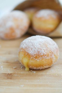 Meyer Lemon Doughnuts //  curd:  1/2 cup Meyer lemon juice 2 teaspoons Meyer lemon zest 1/2 cup sugar 2 large eggs 1/2 cup butter pinch of salt doughnuts: 1 (1/4-oz) package active dry yeast (2 1/2 teaspoons) 2 tablespoons warm water 3 1/4 cups all-purpose flour plus additional for sprinkling and rolling out dough 1 cup whole milk  1/2 stick unsalted butter, softened 3 large egg yolks 2 tablespoons sugar + 3/4 cup to roll the finished doughnuts in 1 1/2 teaspoons salt 1/2 teaspoon cinnamon