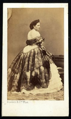 1860s France - her neckline seems to be scandalously low in the back!