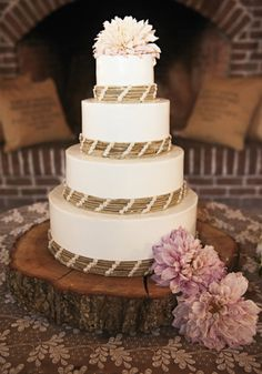 I love this cake! It would be really cool instead of the twine it was sweet grass and the flowers were white hydrangeas!