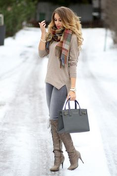 Love the baggy v-neck sweater and those boots are so cool
