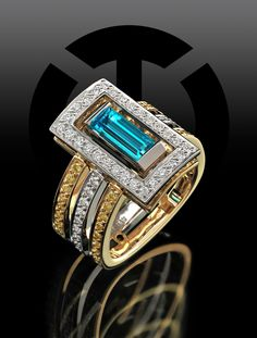 From our Interlude Collection – 1.00 carat baguette cut Paraiba Tourmaline set in 18k Yellow Gold and Platinum accented with Natural Fancy Yellow and White Diamonds.  http://www.coffinandtrout.com/products/interlude-150-r40-fashion/  #coffinandtrout #jewelr