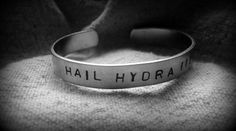 $20. Click through to get yours now: use coupon code PIN10 to save 10% on your entire order! What's not to love? HAIL HYDRA Hand Stamped Aluminum Marvel by fandomoniumdesigns #HAILHYDRA #Marvel #AgentsofSHIELD