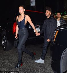 Taking the lead: Bella Hadid and The Weeknd were seen putting on a serious public display of affection on Tuesday night in New York following weeks of romance rumours