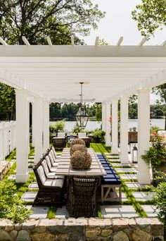 lake house. vacation house. white pergola. backyard design ideas. indoors out. beach theme tablescape.