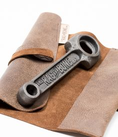 Our opener celebrates the shape of an early and rare classic British motorcycle conrod. Our bottle opener is presented in a leather pouch inspired by the traditional motorcycle tool roll and is cast from grade 17 refined grey iron from a British foundry. The opener has been finished using a blend of pure linseed oil and white beeswax to protect its surface. #realale #craftbeer #gift #brewing