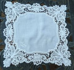 "Antique wedding hanky with fine creamy white linen lawn is edged with hand made Branscombe tape lace and finished with an embroidered moniker, ""Isabelle""."