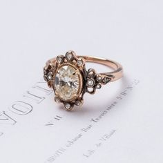 vintage-inspired diamond engagement ring set in oxidized rose gold