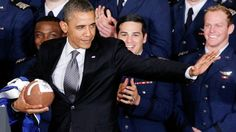 Associated Press photo - Obama strikes Hesiman pose for Air Force Academy football team