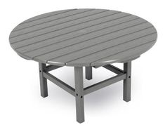 POLYWOOD® Round Coffee Table A popular pick for outdoor scenes. This round coffee table is perfect to use with a set of chaise lounge chairs out by the pool. Eco friendly and ultra durable. #polytables