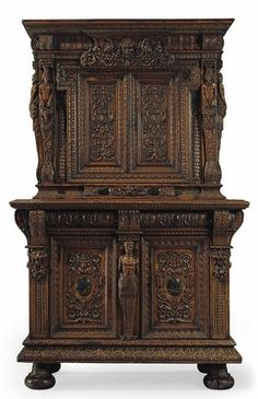 AN HENRI IV GREEN MARBLE-INLAID WALNUT ARMOIRE A DEUX CORPS - BURGUNDY, LAST QUARTER OF THE 16TH CENTURY