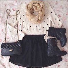 black high waisted skater skirt, black combat boots, white long sleeve crop top, and wool infinity scarf.