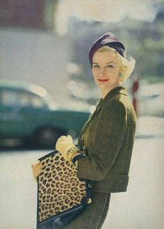 Sunny Harnett in a plaid suit and leopard skin purse forVogue, 1956.