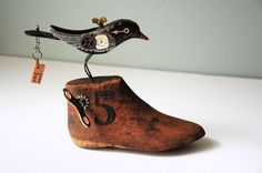 Hand carved wood blackbird with Steampunk theme mounted on vintage shoe form. $65.00, via Etsy. @Susan Vernuccio
