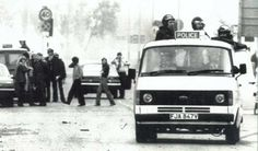 The Moss Side riots of 1981: 48 hours of mayhem.  Officers in a police van patrol the streets of riot-hit Moss Side.