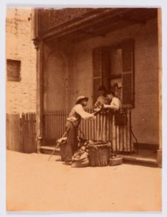 A hawker sells his wares in the street in Sydney, New South Wales in the 1880s.