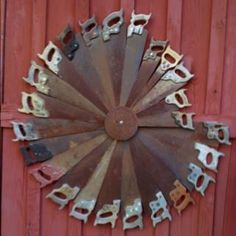 saw old rustic saws in a windmill shape on side of red barn