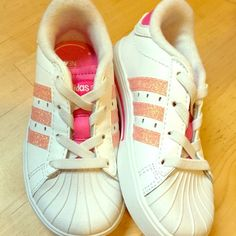 Pink Glitter Kids Shelltoes Kids size 7 (toddler). Brand new! Completely adorable. No laces so super easy. Adidas Shoes Athletic Shoes
