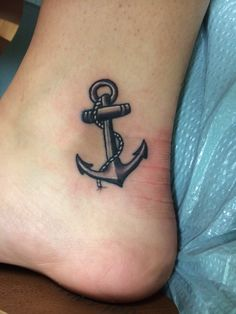 perfect anchor tattoo on inside of lower ankle.