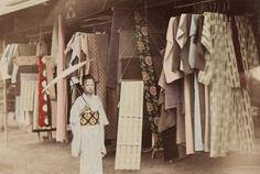 """tsmskimonoyokubo:    athousandpicturesamillionwords:    """"Clothing Shop"""" taken by Kusakabe Kimbei    WOW! Look at her cool shibori obi! - TSM"""