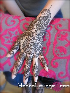 Instead of the hard line of the logo, something swirly similar to henna tattoos