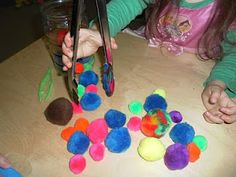 using tongs and tweezers to pick up pom poms