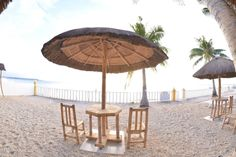 Beachside cabanas just outside the restairant and bar at Lanas Beach Resort