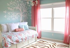 Coral and turquoise bedroom (but not the brown and white tiger-striped rug).