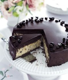 """Frozen mocha cake with chocolate ganache glaze from Bon Appétit Magazine - Eat Your Books is an indexing website that helps you find & organize your recipes. Click the """"View Complete Recipe"""" link for the original recipe."""