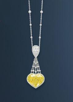 Yellow and White Diamond Necklace - 21.40 ct heart-shaped fancy vivid yellow diamond - 2.35 ct pear-shaped white diamond - micro pave-set diamond surround - 18 k gold -  $3,137,155 at auction