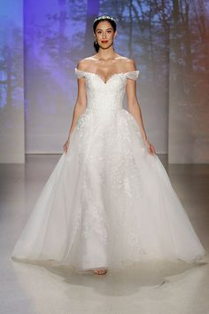Who hasn't dreamt of the perfect fairytale wedding, or looking like their favorite Disney Princess on that special day? Alfred Angelo, who is the designer behind our favorite Disney Princess-inspired quince dresses, is helping make that wish a reality!