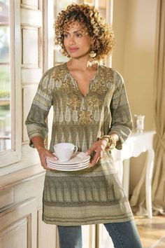 """Unique enough to be a conversation starter, this remarkable Argentine-inspired tunic rises to fashion art. A heavy fabric wash gives the cloth a rich, vintage feel. The notched scoop neck is adorned with a soutache of beads, sequins and zardozi beads. V-neck, 3/4sleeves, and side slits complete this confident piece. Camel. Cotton/linen. Misses 34"""" long. Pampas Tunic #2AM74"""