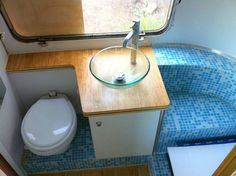 "Remodeled bath in a trailer. They used 1/8""-thick 3/4""-wide tiles avoid weight and breakage from movement. Brilliant! And lovely."