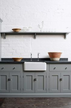 gray kitchen cabinets and painted white brick backsplash. / sfgirlbybay