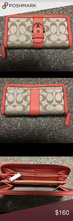 👜NWT Coach Campbell Signature Buckle Zip Wallet👜 NWT Attached light khaki and coral wallet. Lined interior, 12 credit card slots, 2 full length bill compartments, center coin zippered pocket. Exterior full length slip pocket.  Zippered closure. Coach Bags Wallets