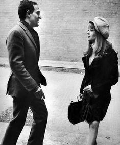 """French director, Francois Truffaut and English actress, Julie Christie, during the filming of, """"Fahrenheit 451"""" (1966)."""